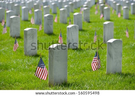 Arlington National Cemetery with a flag next to each headstone during Memorial day - Washington DC United States  - stock photo