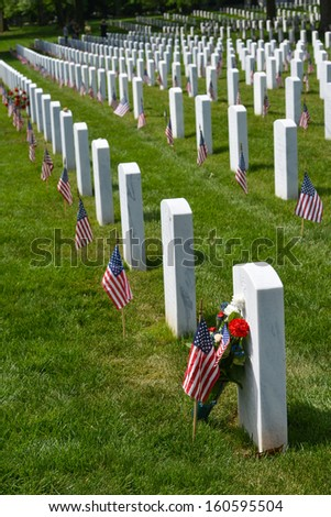 Arlington National Cemetery with a flag next to each headstone during Memorial day - Washington DC United States