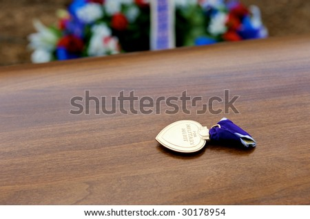 Arlington National Cemetery with Purple Heart metal on top of casket prior to burial - stock photo