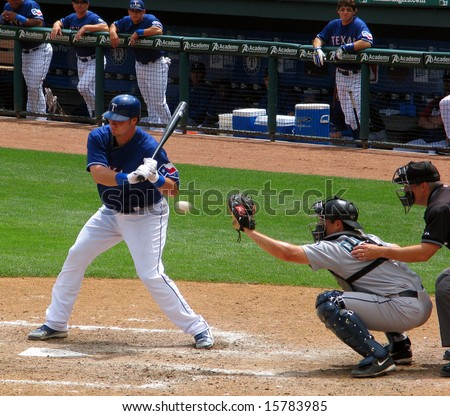 ARLINGTON, TEXAS - May 3, 2008 - A Texas Ranger professional baseball player batting during a game against the Seattle Mariners. - stock photo