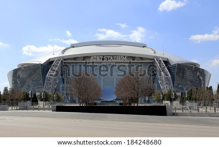 ARLINGTON, TX - MARCH 14: AT&T Stadium located in Arlington, Texas on March 14, 2014. Formerly known as Cowboys Stadium, the multipurpose stadium is home to the Dallas Cowboys of the NFL. - stock photo