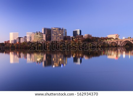 ARLINGTON, VA - November 10:  Landscape of Arlington, Virginia on November 10, 2013 showing an illuminated city reflecting in the Potomac River as seen from Georgetown in Washington, DC.