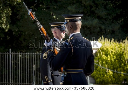 ARLINGTON, VA - SEPT 11, 2015: The relief commander and sentinel during the changing of the guard ceremony at the Tomb of the Unknown Soldier in Arlington National Cemetery. - stock photo