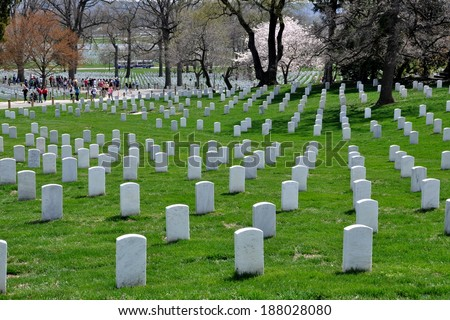 Arlington, Virginia - April 12, 2014:  Row upon row of standardised white soldiers' graves at Arlington National Cemetery