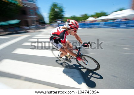 ARLINGTON, VIRGINIA - JUNE 9: A cyclist competes in the U.S. Air Force Cycling Classic on June 9, 2012 in Arlington, Virginia - stock photo