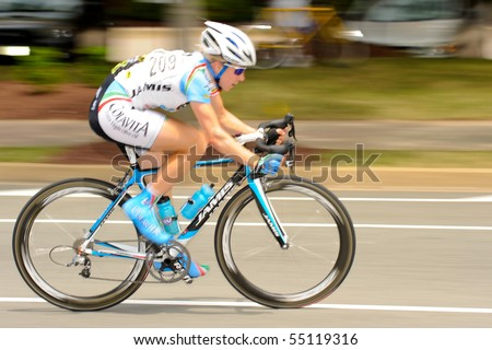 ARLINGTON, VIRGINIA - JUNE 13: A cyclist competes in the U.S. Air Force Cycling Classic on June 13, 2010 in Arlington, Virginia - stock photo