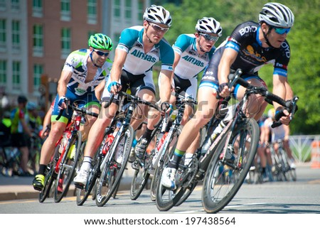 ARLINGTON, VIRGINIA - JUNE 8: Cyclists compete in the elite men's Crystal Cup race at the Air Force Cycling Classic on June 8, 2014 in Arlington, Virginia - stock photo