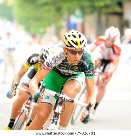 ARLINGTON, VIRGINIA - JUNE 11: Cyclists compete in the U.S. Air Force Cycling Classic on June 11, 2011 in Arlington, Virginia. - stock photo