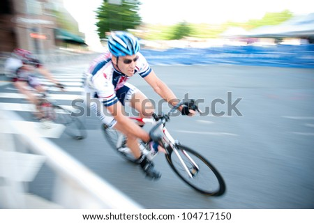 ARLINGTON, VIRGINIA - JUNE 9: Cyclists round the corner in the Masters 40+ race at the U.S. Air Force Cycling Classic on June  9, 2012 in Arlington, Virginia - stock photo