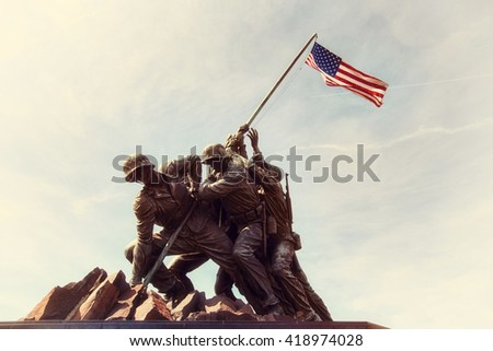 ARLINGTON, VIRGINIA, USA - MARCH 30, 2016. Iwo Jima U.S. Marine Corps War Memorial in Rosslyn, a military memorial statue. Editorial image only Retro Instagram style.  - stock photo