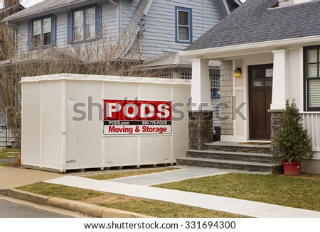ARLINGTON, VIRGINIA, USA - MARCH 1, 2013: PODS storage container in front of houses.