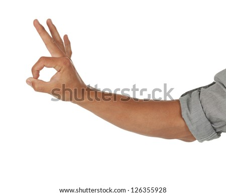 arm and hand showing an ok sign isolated on white - stock photo