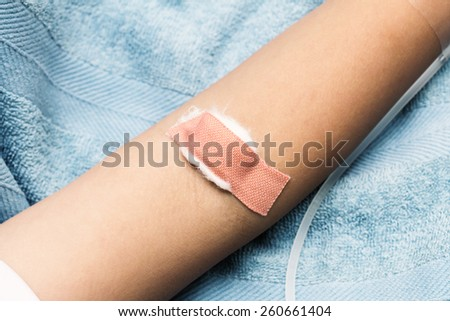 arm covered plaster after drawn blood
