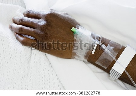 Arm of patient with drip - stock photo