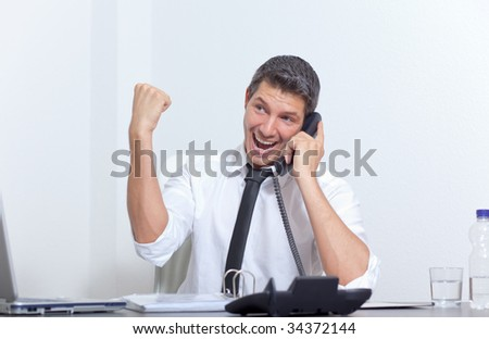 Arm rising happy male chief manager phoning while getting professional career advancement - stock photo