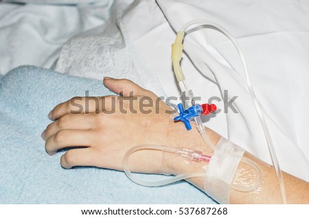 arm with a young person intravenously in a hospital