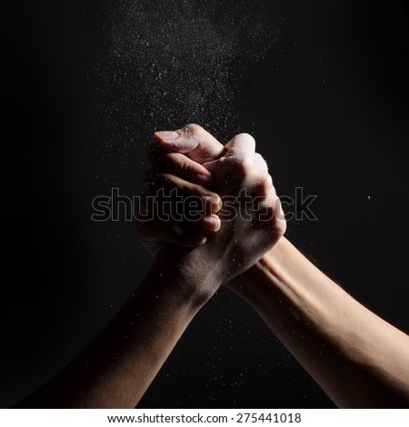 arm-wrestle of two man on black background - stock photo