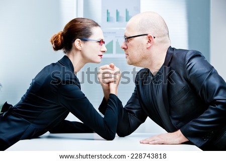 arm wrestling business woman VS business man - stock photo
