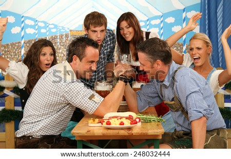 arm wrestling in the marquee - stock photo