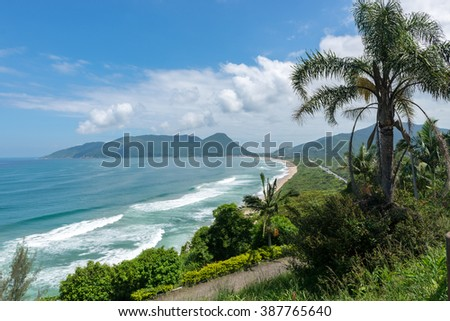 Armacao beach in Florianopolis, Santa Catarina, Brazil. One of the main tourists destination in south region. - stock photo