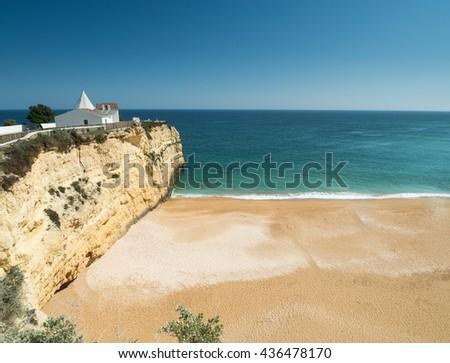 ARMACAO DE PERA, PORTUGAL -MAY 18: A view of  the chapel Capela Nossa Senhora da Rocha on the coast Algarve near city Armacao de Pera in the south of the country, Portugal, 2016 - stock photo