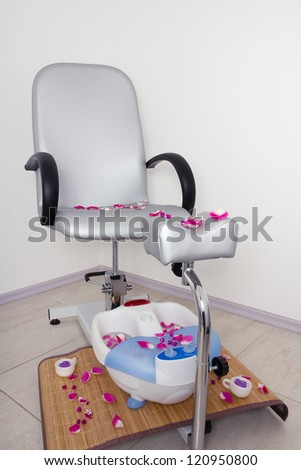 Armchair and electric foot spa in the pedicure cabinet in the beauty salon