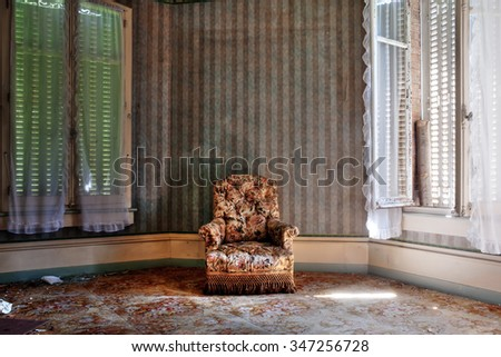 Armchair in an abandoned room - stock photo