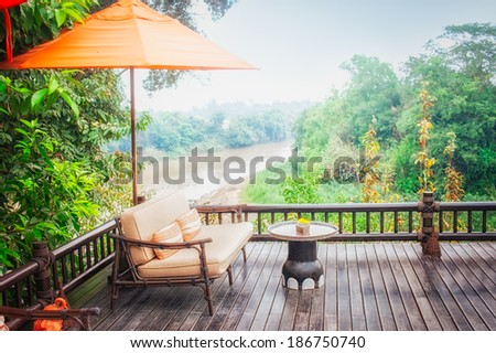 armchairs and river  view on the Terrace - stock photo