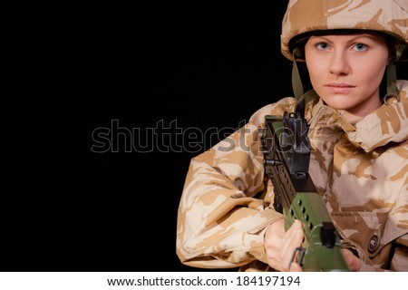 Armed Female Soldier - stock photo