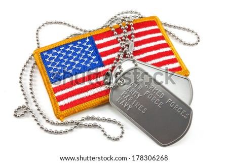 Armed forces dog tags and American Flag - stock photo
