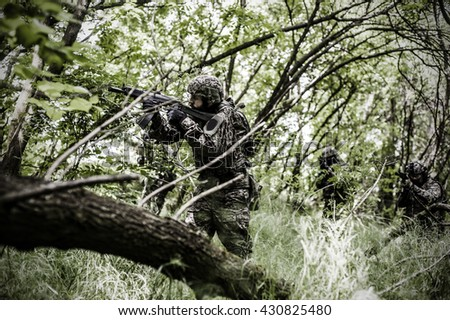 Armed forces in woods