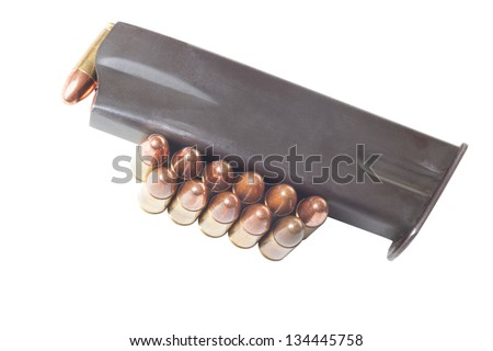 Armed gun holder and two rows of 9mm bullets isolated on white background - stock photo