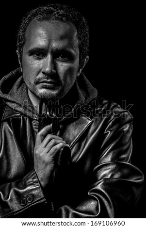 Armed guy, hief concept, man in balck and white - stock photo