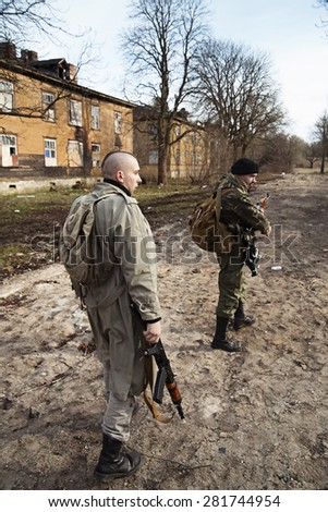 Armed males are on the millitary mission - stock photo
