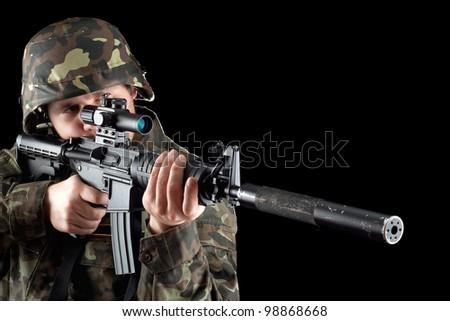 Armed man taking aim in studio. Closeup - stock photo