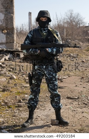 Armed officer with an automatic rifle in full ammunition - stock photo