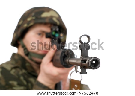 Armed soldier holding svd in studio. Focus on the rifle barrel - stock photo
