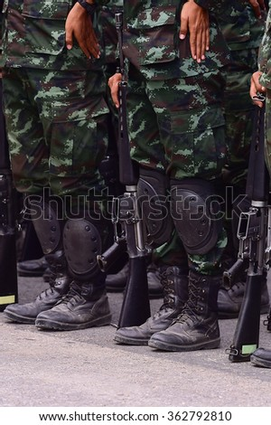 Armed Soldiers in Camouflage Military Uniform with Weapon.