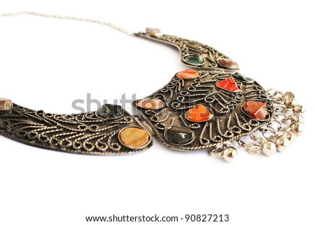 Armenian ancient style necklace with natural stones isolated on white background. - stock photo