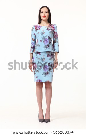 armenian asian east brunette business executive woman with straight hair style in blue printed floral two pieces jacket skirt suit high heels shoes full length body portrait standing isolated on white - stock photo