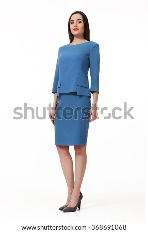 armenian asian eastern brunette business executive woman with straight hair style in blue blouse and  skirt suit  high heels shoes full length body portrait standing isolated on white - stock photo