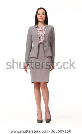 armenian asian eastern brunette business executive woman with straight hair style in gray official two pieces suit jacket skirt high heels shoes full length body portrait standing isolated on white - stock photo