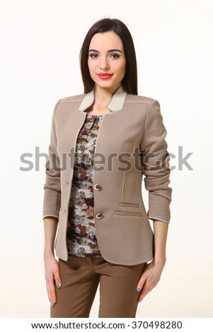 armenian asian eastern brunette business executive woman with straight hair style in military khaki blouse riding   jacket and trousers close up photo isolated on white - stock photo