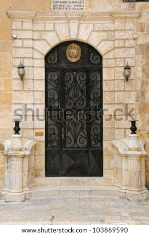Armenian emblem on the door, St James Cathedral, Jerusalem - stock photo