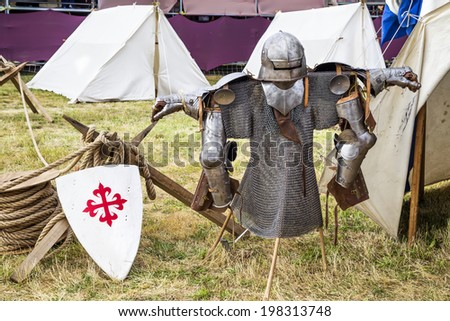 Armor in a medieval camp - stock photo
