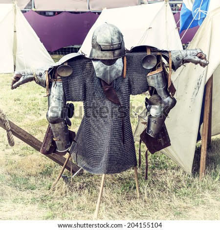 Armor in a medieval camp. Vintage effect. - stock photo