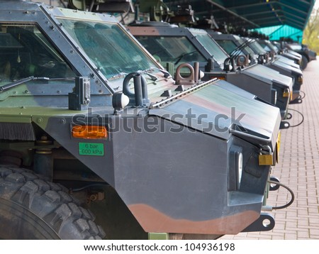 Armored army vehicles lined up in formation - stock photo