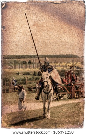 Armored knight on warhorse - retro postcard on vintage paper background - stock photo