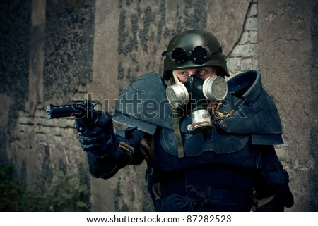 armored postnuclear fighter aiming his gun