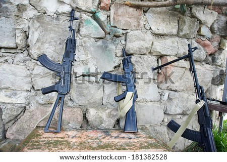 Armory mountain militants in trench - stock photo
